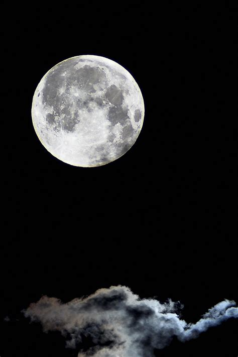 The Full Moon Looms Over Clouds | The full moon was