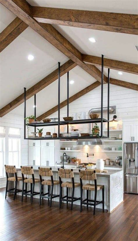 Open concept kitchen with vaulted ceilings, exposed beams